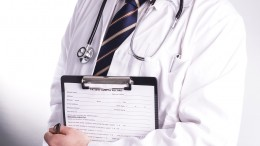 Male Doctor Ready To Write Patient Information