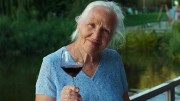 Elderly Woman With Glass Of Wine